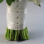 Bridal bouquet of white flowers - peonies, white ranunculus and lisianthus, freesia, sage. No roses!