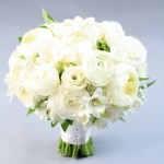 Bridal bouquet of white flowers - peonies, white ranunculus and lBridal bouquet of white flowers - peonies, white ranunculus and lisianthus, freesia, sage. No roses! isianthus, freesia, sage. No roses!