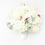 Bridal bouquet of white roses, white ranunculus, white orchids dendrobium, white purple calla lily Picasso, spray roses,grey dusty miller, lisianthus.