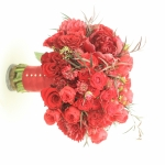 Red wedding bouquet with red peonies, red garden roses, scabiosa and spray roses, agonys. Red bridal bouquet