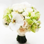 White ivory green wedding bouquet with ivory roses, green and white orchids, spray roses. Ivory green bridal bouquet