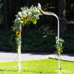 Wedding arch with asymmetric flower design