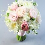 Bridesmaids' bouquet of white and pink flowers -white and pink ranunculus and blush lisianthus, freesia, tulips and baby breath sage. No roses!