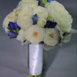 White, royal blue, gray flowers for bridesmaid's bouquet