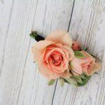 Groomsman boutonniere of peach spray rose