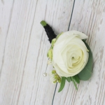 Groom's boutonniere of white ranunculus