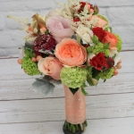 Bridesmaid bouquets Peach, ivory and blush colors with red hints