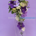 Cascading bridal bouquet  with green roses and purple orchids