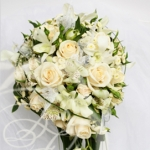 Cascading bridal bouquet with cream roses and white orchids