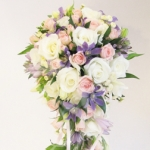 Cascading bridal bouquet  with white and pink roses and purple flowers