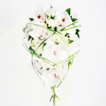 Cascading bridal bouquet with white roses and orchids
