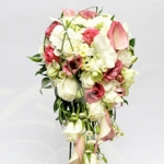 Cascading bridal bouquet with white roses and pink calla lilies