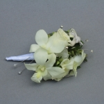 Lady's corsage of white orchids