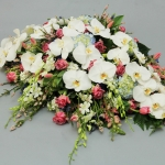 casket spray with orchids