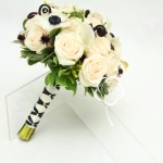 The bridal bouquet of creamy  and white flowers