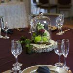 organic-bogo-style-wedding-centerpiece-wood-slice-red-roses-moss-1