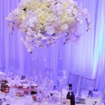 Luxury-white-flowers-tall-centerpiece-orchids