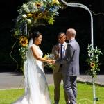 Wedding arch with asymmetric flower design