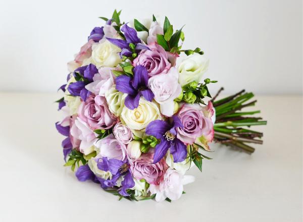 Vintage purple bouquet of lavender roses ans clematis