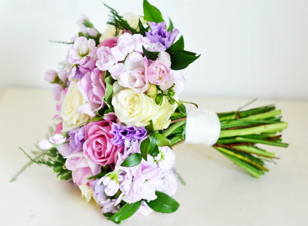 Vintage purple bouquet of pink roses ans clematis