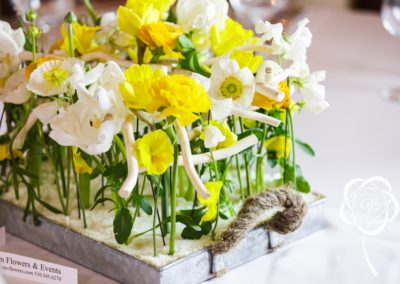 Modern wedding centerpiece in nature like style of white, yellow spring flowers as tupils, ranunculus, daffodils and sweet peas by dream-flowers_dot_com