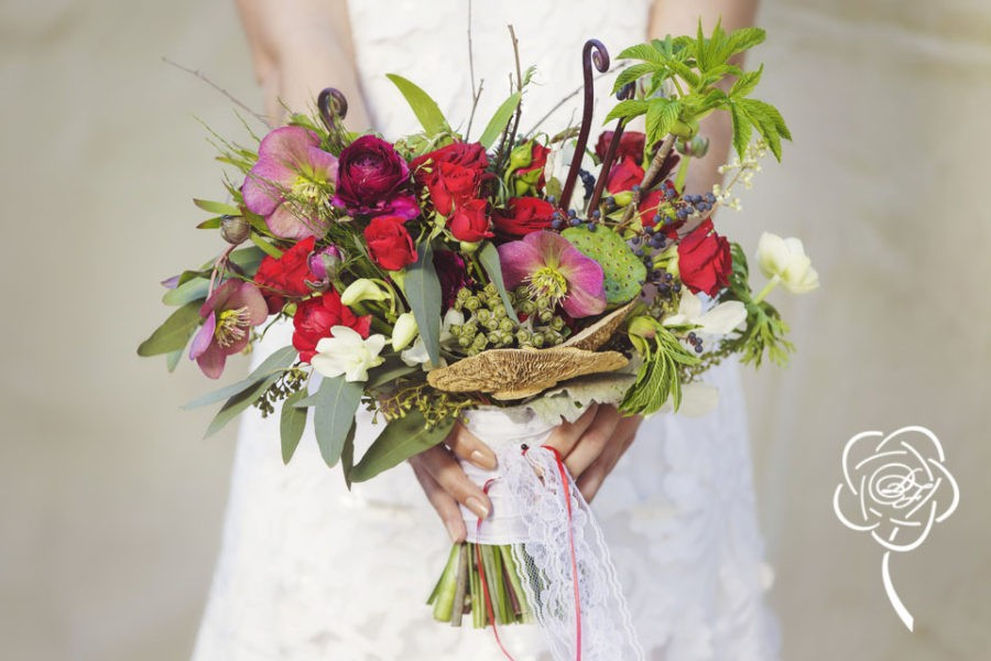 Garden style bouquet with roses, hellebore and mushrooms