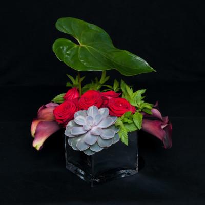 Modern table arrangement red roses succulent