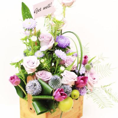 Wooden box arrangement. Everyday flowers