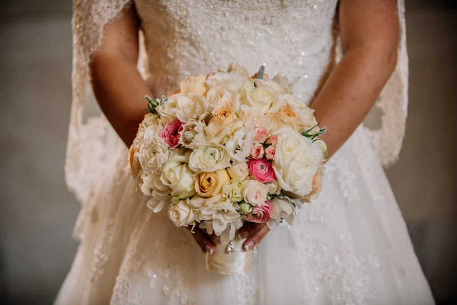 Classic bridal bouquet with roses, ranunculus and blushing bride protea