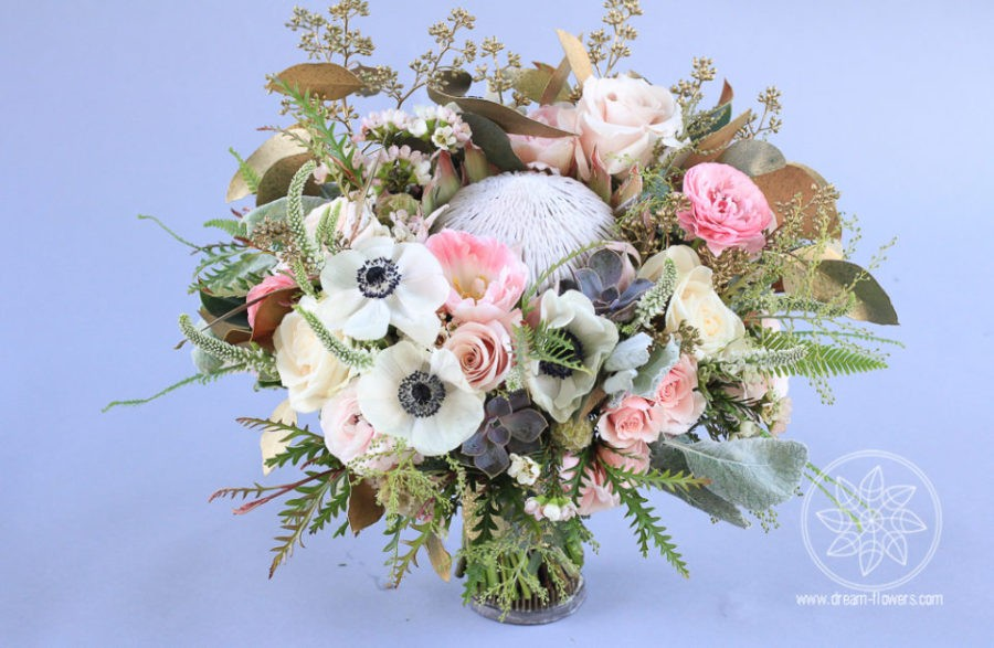 Whimsical bouquet of spring flowers and king protea