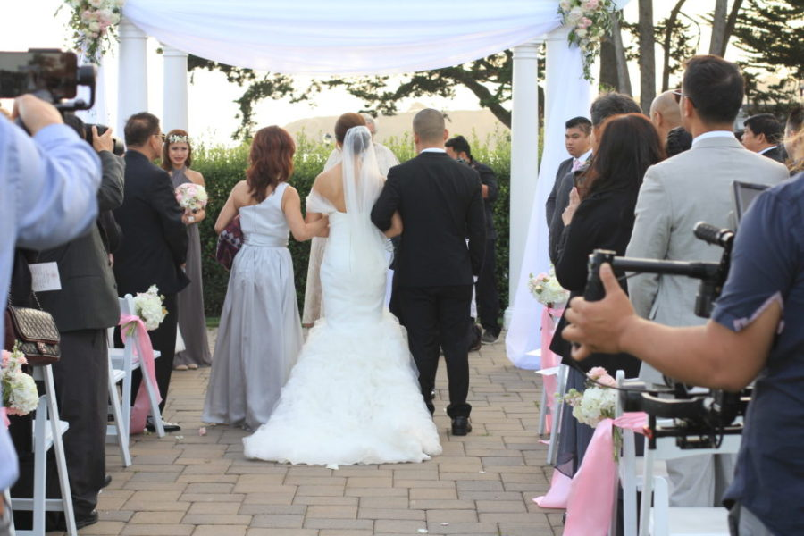Ceremony decor- Arbour with flower sprays at the corners