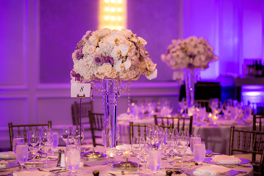 Tall centerpiece of white and lavender flowers for wedding reception