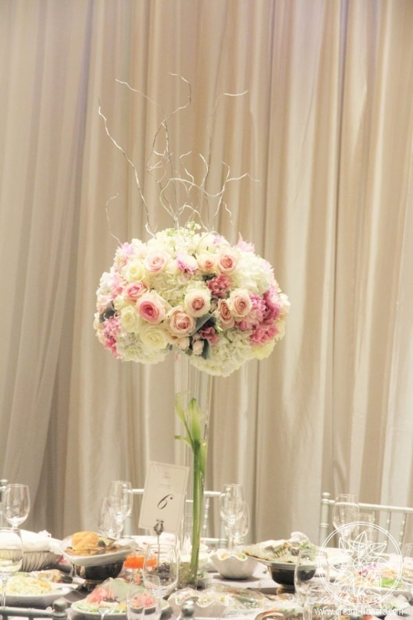 Tall centerpiece of white and pink flowers for wedding reception