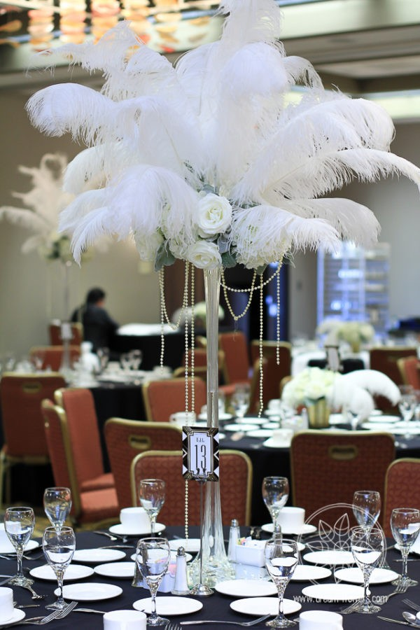 White ostrich feather and flowers centerpiece