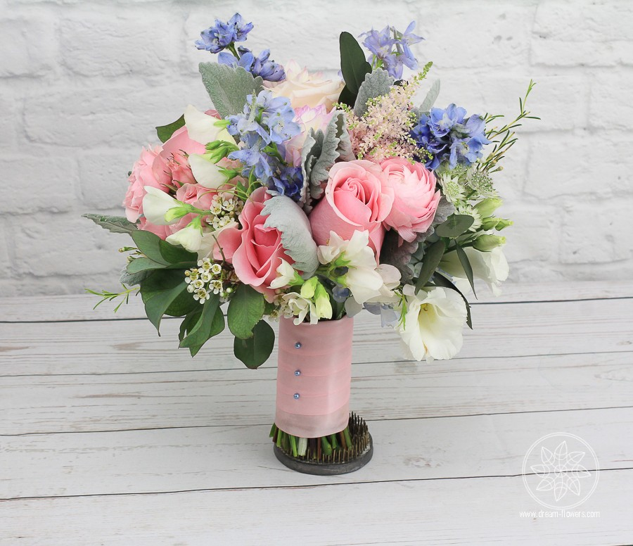 Bredmaid'sl Bouquet of pink roses, blue delphinium, white swet peas, blue hydrangea, pink spray roses, pink ranunculus and dahlias, blue thistle, white lisianthus, white scabiosa, pink astilbe and dusty miller, complimented by eucalipthus and wax.