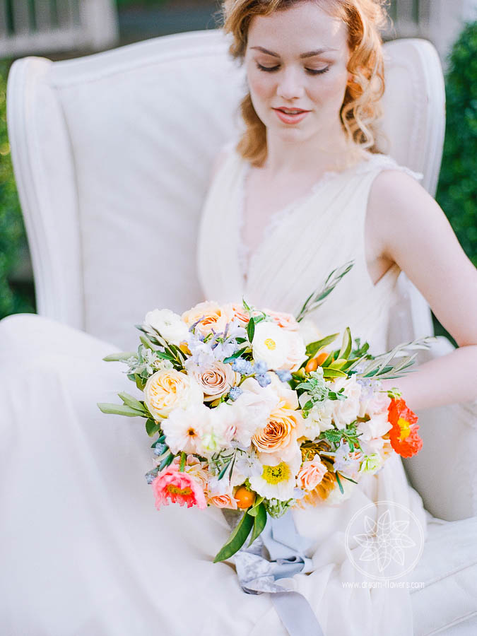 Florals in citrus and blue colors. Editorial photo shoot